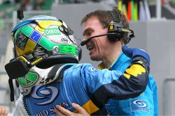 Pole winner Giancarlo Fisichella celebrates