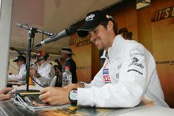 Tiago Monteiro signs autographs