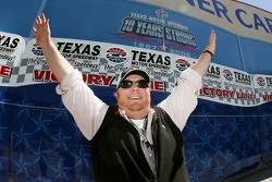 Chef Mario Batali stands on victory lane
