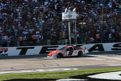 Kasey Kahne crosses the finish line to win the race