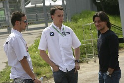 Andreas Zuber talks with Robert Kubica and Giorgio Pantano