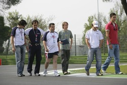 Adrian Valles and Felix Porteiro with crew go on a track walk