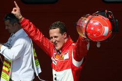 Pole winner Michael Schumacher celebrates