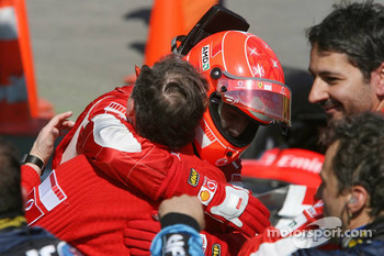 Race winner Michael Schumacher celebrates with Jean Todt