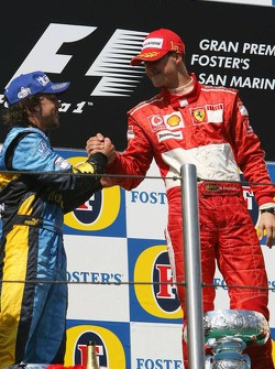Podium: race winner Michael Schumacher with Fernando Alonso
