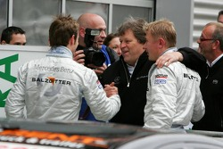 Norbert Haug congratulates pole winner Jamie Green and Mika Hakkinen