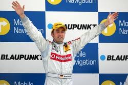 Podium: Race winner Bernd Schneider celebrates