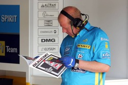 Renault F1 team members reads Red Bulletin