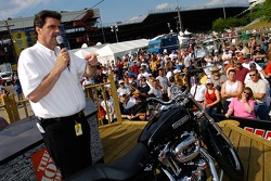 President of NASCAR Mike Helton, autions off a motorcycle to benefit former NASCAR Busch Series Champion Sam Ard prior to the running of the NASCAR Nextel Cup Series Crown Royal 400