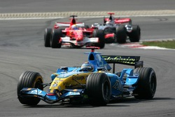 Fernando Alonso leads Felipe Massa