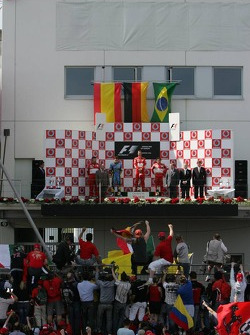 Podium: race winner Michael Schumacher with Fernando Alonso and Felipe Massa