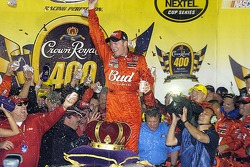 Not only is the beer flying in victory lane, but a few beer cans are flying too as Dale Earnhardt Jr. celebrates