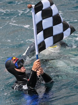 Poseidon Operation: free diver Pierre Frolla with chequered GP flag