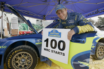 Petter Solberg celebrates his 100th start