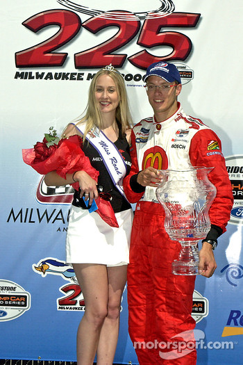 Podium: Race winner Sébastien Bourdais poses with Miss Milwaukee Mile