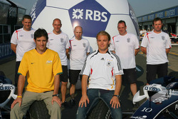 Mark Webber and Nico Rosberg gets into the World Cup spirit