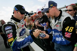 Jimmie Johnson signs an autograph