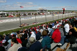 Fans fill the grandstands on a cool and windy day