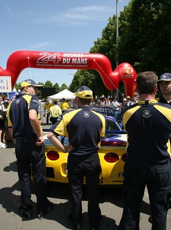Luc Alphand Aventures team members push the Corvette C5-R to scrutineering