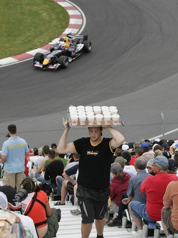 A man selling Budweiser in the crowd
