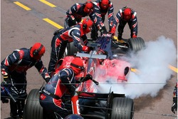 Scott Speed in the pit with engine in fire