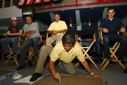 Michael Waltrip puts his name in concrete for the Daytona 500 Champion's Walk Of Fame