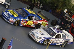 The new NASCAR Ford Fusion car of tomorrow sits alongside the 2006 version of the Ford Fusion