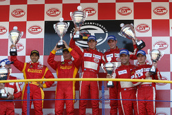 GT2 podium: class winners Nathan Kinch and Andrew Kirkaldy, with second place Mika Salo and Rui Aguas, and third place Chris Niarchos and Tim Mullen