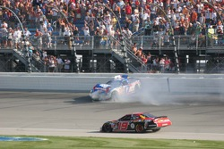 Jeremy Mayfield drives under a spinning Matt Kenseth