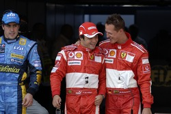 Pole winner Michael Schumacher celebrates with Felipe Massa and Fernando Alonso