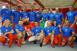 Loris Capirossi and Ducati team members celebrate Italy's win at the World Cup