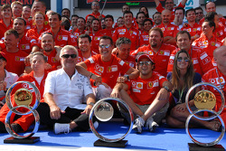Race winner Michael Schumacher celebrates with Felipe Massa and Ferrari team members