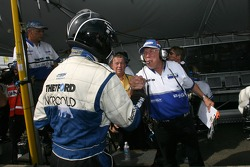 Pole winner Butch Leitzinger celebrates with Dyson Racing crew members