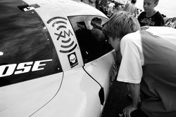 A young fan checks the Corvette Racing Corvette C6-R