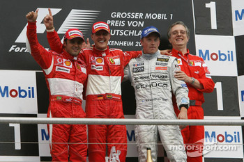 Podium: race winner Michael Schumacher with Felipe Massa, Kimi Raikkonen and Paolo Martinelli