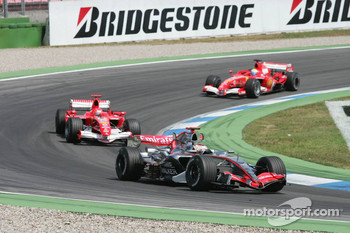 Kimi Raikkonen leads Michael Schumacher and Felipe Massa
