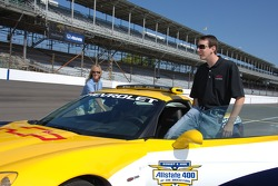 Kyle Busch climbs into the Chevrolet Corvette Z06 pace car