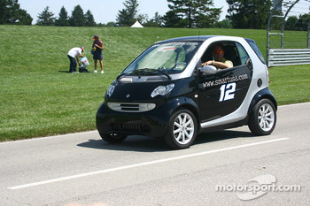 A Smart car sports the colors of Ryan Newman