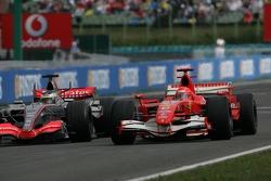 Pedro de la Rosa and Michael Schumacher go side by side