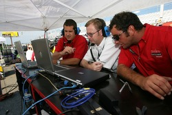 Gainsco/ Blackhawk Racing crew members watch qualifying