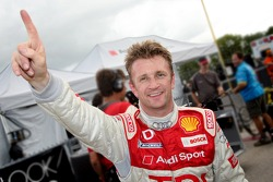 Pole winner Allan McNish celebrates