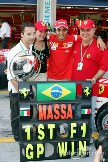 Race winner Felipe Massa celebrates with Nicolas Todt and his parents
