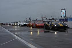 Cars line up on pit lane