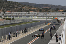 Cars leave the pit lane