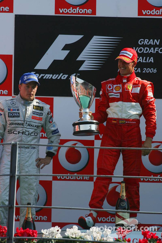 Podium: race winner Michael Schumacher with Kimi Raikkonen