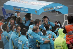 Suzuki team members celebrate second place finish of Chris Vermeulen