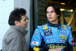 Nelson A. Piquet talks with his father Nelson Piquet