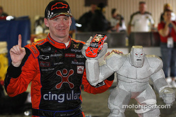 Jeff Burton stands with the winners trophy