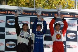 Podium: race winner A.J. Allmendinger with Bruno Junqueira and Sébastien Bourdais