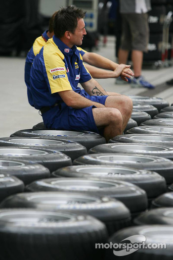 A Honda team member prepares the teams tyres for the weekend